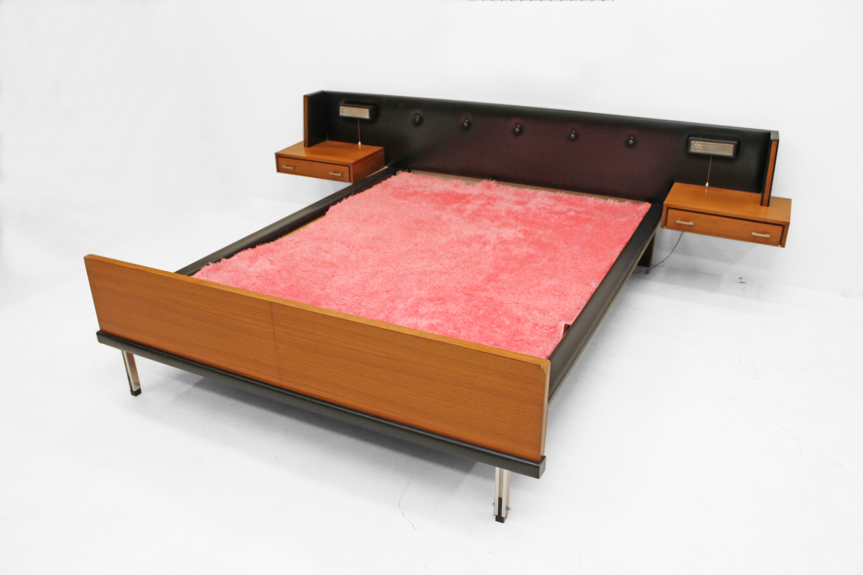 early seventies bed in teak with accents in skai