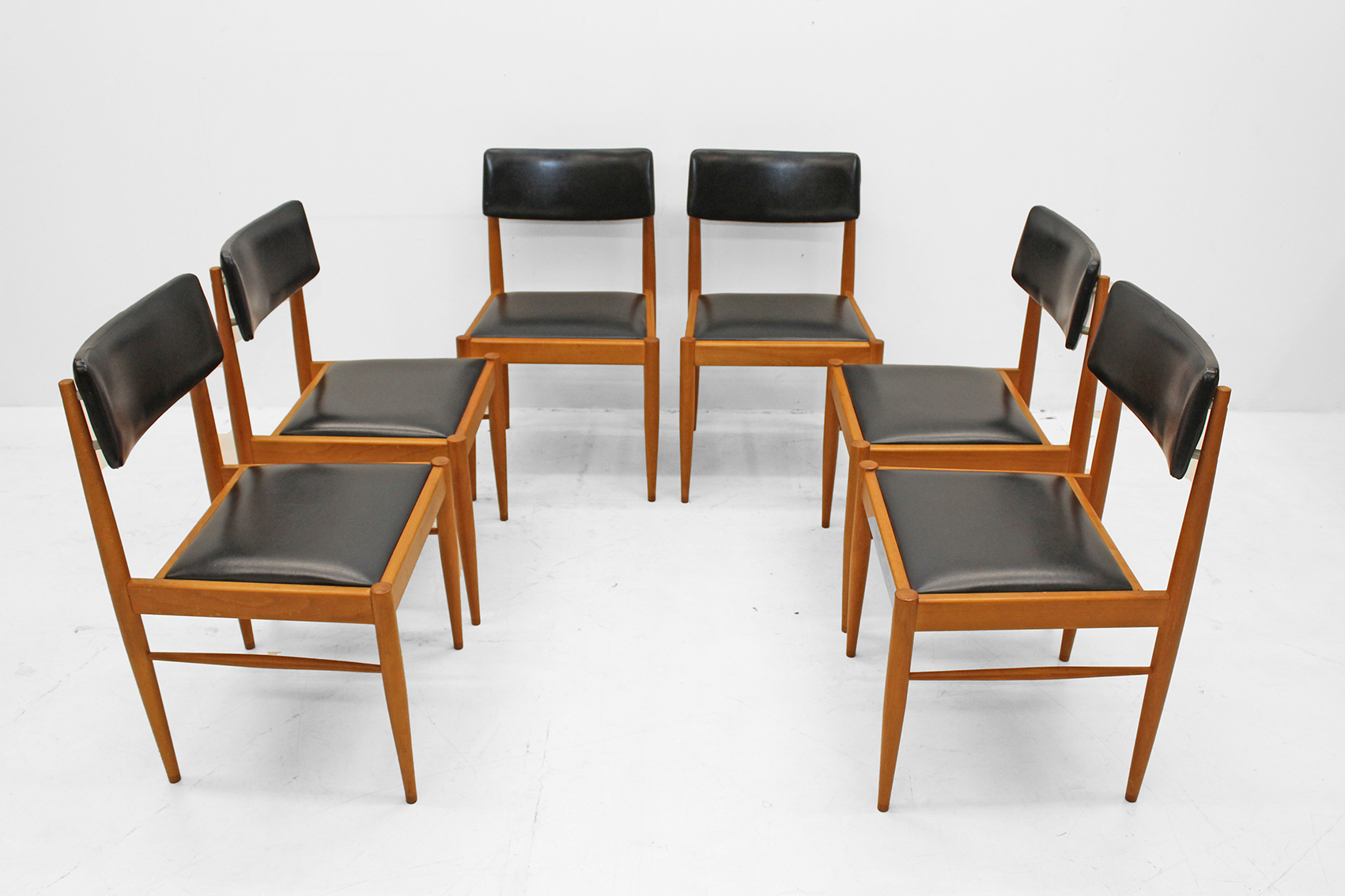 set of six chairs in light teak